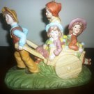 GORGEOUS PORCELAIN FIGURINE GROUP KIDS ON A HAY WAGON RIDE ARTMARE