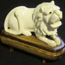 VINTAGE CHINESE ROARING LION FIGURINE HARD RESIN ON THE WOODEN STAND