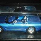 BLUE CHEVROLET CORVETTE CONVERTIBLE MODEL CAR & SMALL COMPANION IN DISPLAY CASE