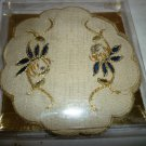 VINTAGE EMBOSSED CLOTH COASTERS SET OF 4 NEW IN A PACKAGE
