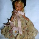 "VINTAGE MINIATURE 7"" DOLL IN DRESS IN BLACK HAT"