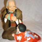 VINTAGE CERAMIC FIGURINE HAKATA URASAKI DOLL OLD WOMAN PLAYING BALL W/BABY JAPAN