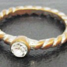 SWIRL RING WITH CLEAR STONE/GLASS BAND