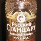 COLLECTIBLE INTRICATE EMBOSSED GLASS RUSSIAN STANDARD VODKA BOTTLE EMPTY
