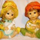 VINTAGE UNIVERSAL STATUARY CHALKWARE SET OF 2 FIGURINES GIRL/CAT & BOY/ PUPPY