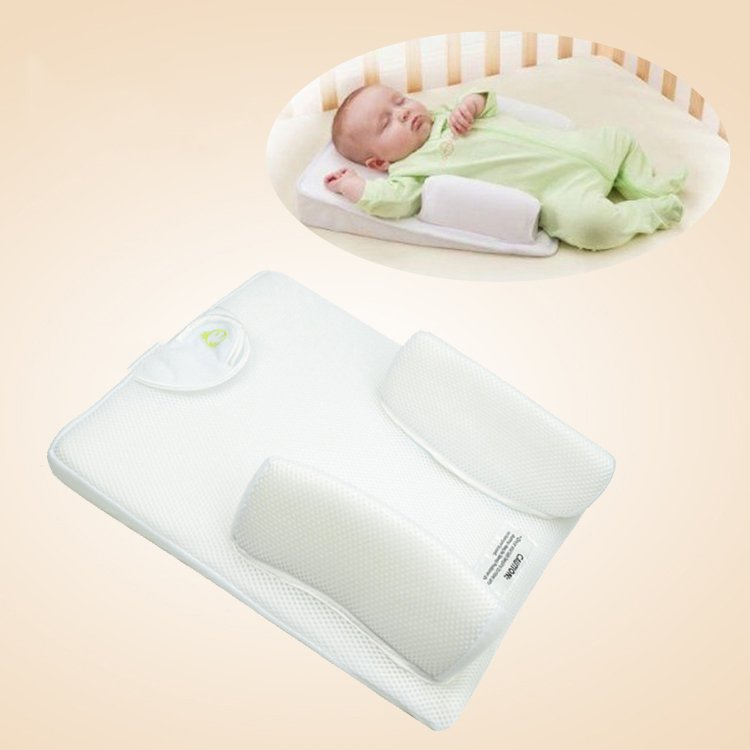 New Born Baby Infant Sleep Positioner Prevent Flat Head Shape Anti Roll Pillow
