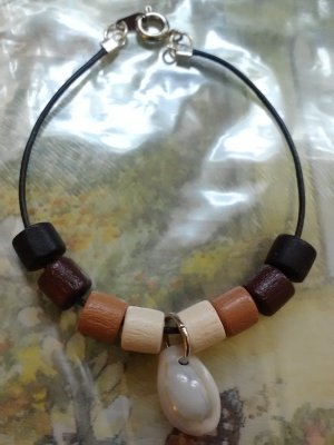 "7"" handmade seashell bracelet with white, tan, brown, and black wood beads"