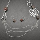 Brown and silver rose necklace and earring set!