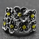 Silver flower ring with yellow jewel accents