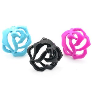 One pair of child's rose earrings