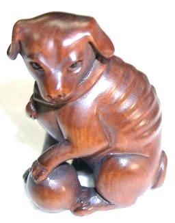 Lovely Boxwood Netsuke: Dog Playing Ball