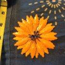 Orange and blue rotating metal flower pin