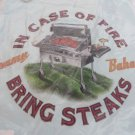 """TOMMY BAHAMA RELAX TEE NWT  """"IN CASE OF FIRE BRING STEAKS"""" LITE BLUE"""
