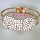Rhinestone Studded Rose Gold Bow Bangle