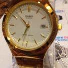 Casio Men's Classic Watch Quartz  With a date Gold tone  brand New