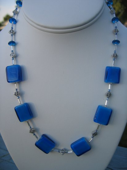 Bright Blue Glass and silver accents