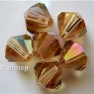 3 8mm Swarovski 5301 Crystal Bicones: Light Colorado Topaz AB