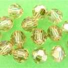 3 6mm Swarovski 5000 Crystal Rounds -- Golden Shadow