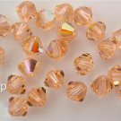 8 4 mm Swarovski 5301 Crystal Bicones -- Light Peach AB