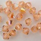8 4 mm Swarovski 5301 Crystal Bicones -- Light Peach AB