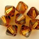 5 6 mm Swarovski 5301 Crystal Bicones -- Topaz Satin