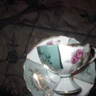 Vintage  Tea Cup and Saucer set. Pink rose and green