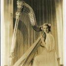 Anita Louise at her Harp