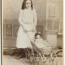 Child with a Baby in a Wicker Stroller