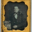 Daguerreotype of a Man Holding a Book
