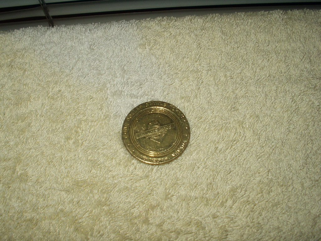 palace station las vegas $1 dollar gold colored token vintage