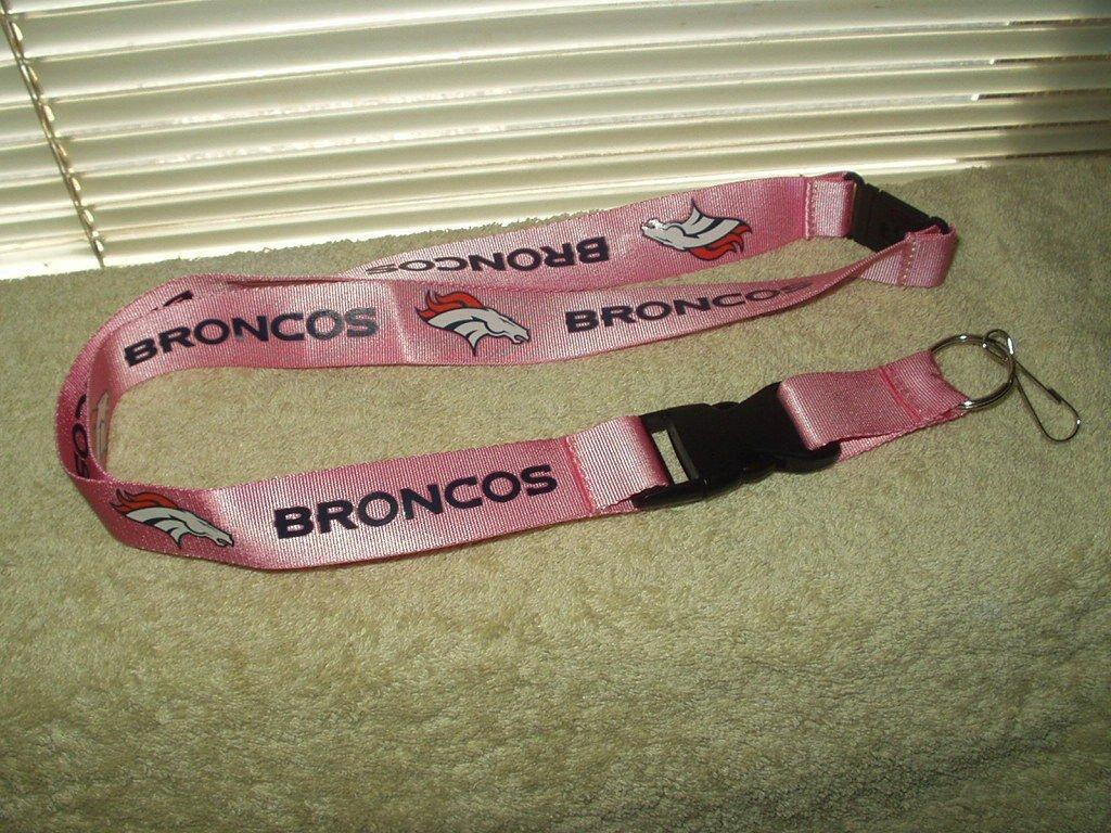 denver broncos lanyard orange / pinkish colored unsnaps aminco brand