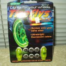 TIREFLYS UV GREEN WHEEL VALVE STEM FLASHING LIGHTS MOTION ACTIVATED SET OF 2 IN PACKAGE