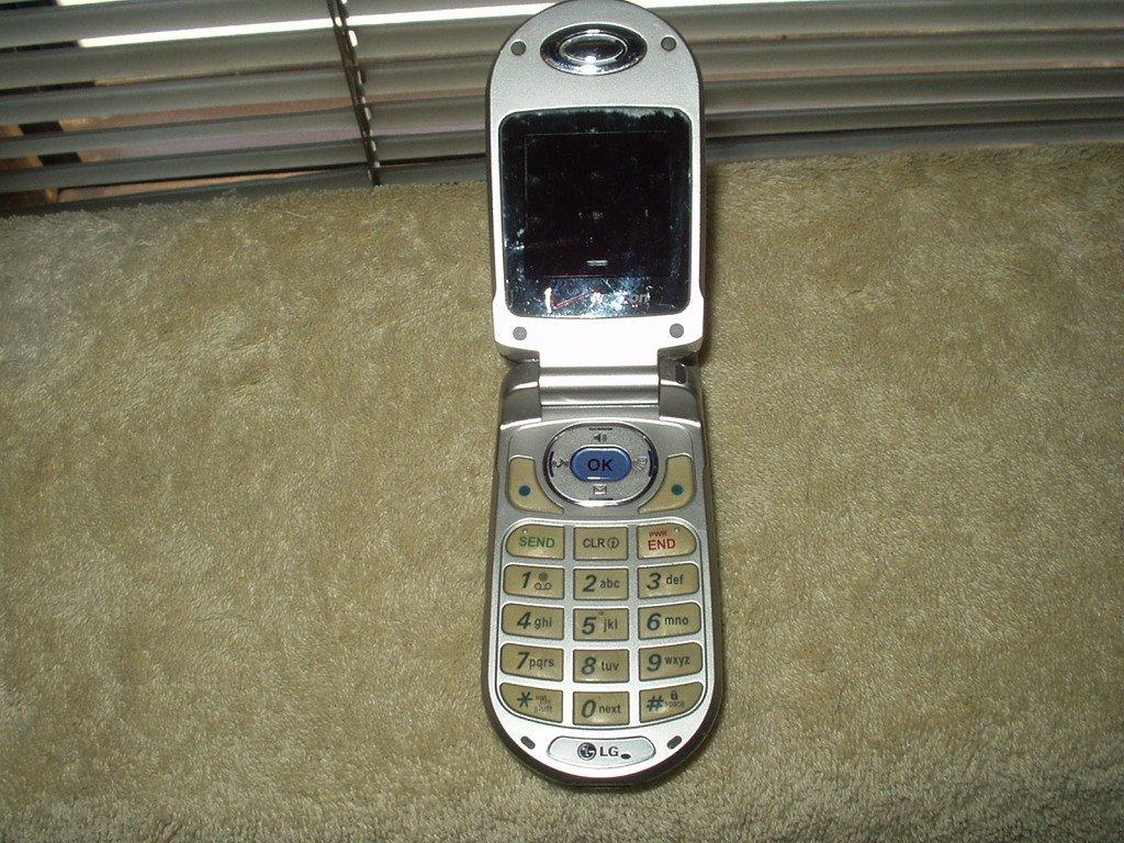 lg vx3200 flip phone verizon w/ lgip-a1000e battery for parts or repair