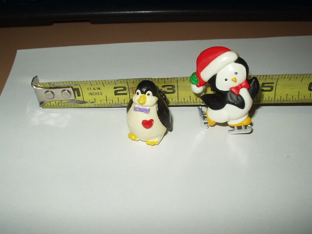 xmas penguin on skates 1983 hallmark & thick penguin w/ bowtie & red heart pin