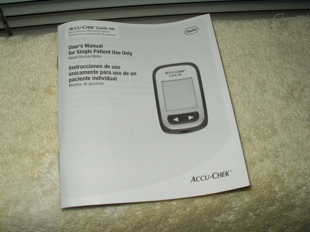 accu-chek guide me users manual  only in english & spanish