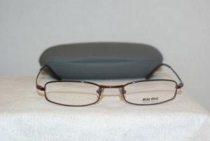 B. New Miu Miu Burgundy Eyeglasses: Mod. VMU 62A & Case