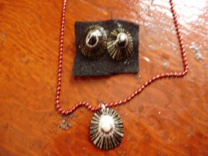 NEW. Item 026. Black and gold Limpet shell necklace with matching earrings.