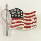 OLD GLORY FLAG BROOCH IN SILVER TONE WITH PASTEL BLUE CRYSTAL ACCENTS