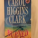 BURNED - A REGAN REILLY MYSTERY BY CAROL HIGGINS CLARK IN SOFT COVER BOOK 8