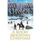 A ROCKY MOUNTAIN CHRISTMAS BYWILLIAM W JOHNSTONE & JA JOHNSTONE IN SOFT COVER FR