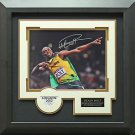 Usain Bolt Autographed 2012 Olympic Photo Framed