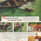 "1951 Canadian Club Ad ""Roping this man-eater"""