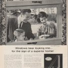 "1961 Libbey Owens Ford Ad ""Windows bear looking into"""