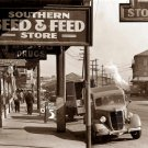 REPRODUCTION ANTIQUE PHOTO:SEPIA: STORY UNKNOWN: ANTIQUE CARS SEED FEED STORE