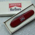 Vintage 1990s Victorinox Adventure Team Officer Suisse Pocket Knife