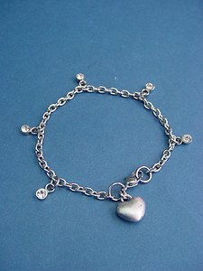 hand-brushed heart and dangling stones charms bracelet in s.steel 401