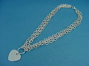 Shiny heart pendant on three rolo chains 707
