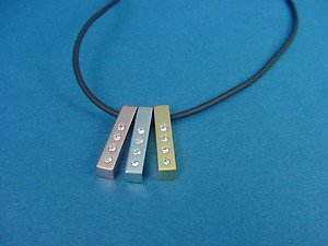3 s.steel pendants in silver, gold and rose gold each with 4 white crystals 519
