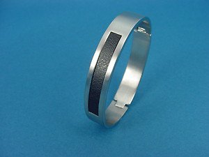 brushed bangle in silver colored stainless steel with black PU inlay 556