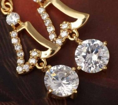 9 Karat Yellow Gold Plated Costume Dangle Earrings Clear Zircon Solitaire
